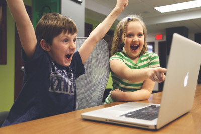 Excited Kids with Laptop